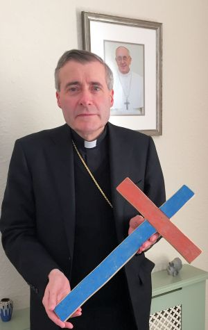 Bishop Mark holding the Lampedusa Cross