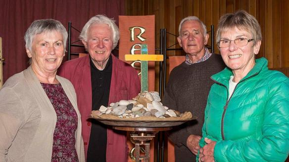 Margaret Perry, Canon George Browne, Wally Perry and Mary Glennon with the Cross. Picture by John Hopkins, South Warrington News